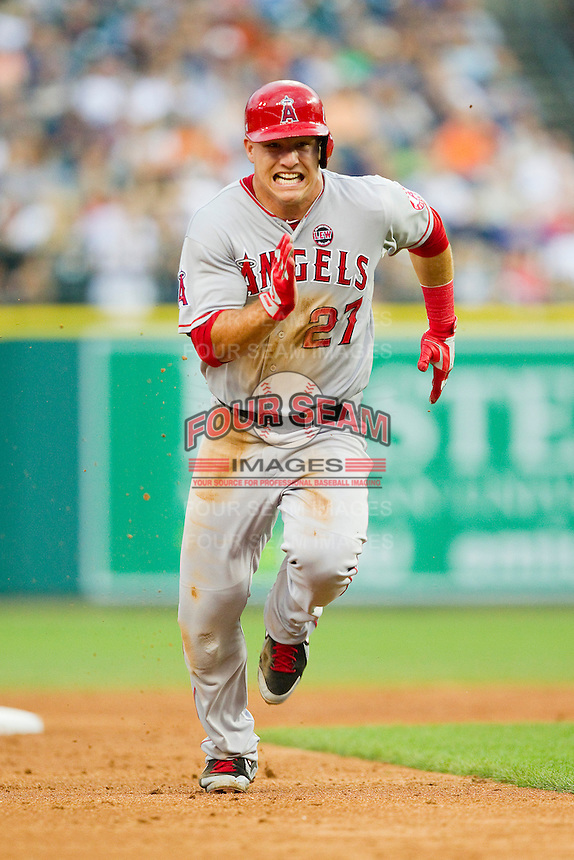 Mike Trout (27) of the Los Angeles Angels takes off for third base against the Detroit Tigers at Comerica Park on June 25, 2013 in Detroit, Michigan.  The Angels defeated the Tigers 14-8.  (Brian Westerholt/Four Seam Images)