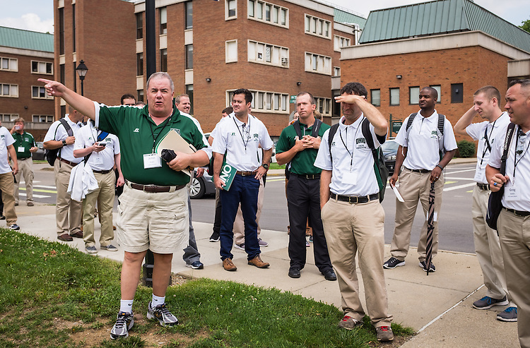 Master's in Athletic Administration faculty member John Evers describes Ohio University's campus and the PIng Center during a walking tour of campus on Friday, June 26, 2015. © Ohio University / Photo by Rob Hardin