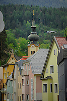 Pastel coloured buildings and church steeple. Imst district,Tyrol, Austria.