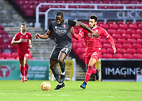 Lincoln City's John Akinde vies for possession with Swindon Town's Keshi Anderson<br /> <br /> Photographer Andrew Vaughan/CameraSport<br /> <br /> The EFL Sky Bet League Two - Swindon Town v Lincoln City - Saturday 12th January 2019 - County Ground - Swindon<br /> <br /> World Copyright &copy; 2019 CameraSport. All rights reserved. 43 Linden Ave. Countesthorpe. Leicester. England. LE8 5PG - Tel: +44 (0) 116 277 4147 - admin@camerasport.com - www.camerasport.com