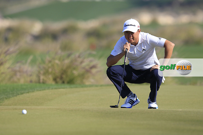 David Lipsky (USA) lines up his birdie putt on the 9th green during Thursday's Round 2 of the 2015 Commercial Bank Qatar Masters held at Doha Golf Club, Doha, Qatar.: Picture Eoin Clarke, www.golffile.ie: 1/22/2015