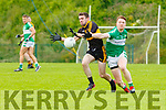 Brendan Falvey Dr Crokes and Darragh O'Doherty Legion contest for the ball during the League game in Lewis Road on Sunday