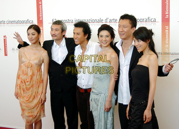 "KIM SO YEUN, TSUI HARK, DONNIE YEN, CHARLIE YOUNG, SUN HONGLEI & ZHANG JINGCHU.Photocall of the film ""Seven Swords"",.62nd International Film Festival,.Venice, 31st August 2005.half length director actor black suit whitr shirt orange strappy dress blue strapless hand movie .www.capitalpictures.com.sales@capitalpictures.com.© Capital Pictures."
