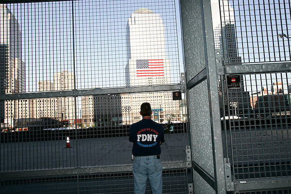 Today marked the 4th anniversary of the September 11th attacks on the World Trade Center in New York and the Pentagon in Washington DC. Thousands turned out at the Ground Zero site in New York to remember those killed in the attacks. A firefighter gazes at the site of the 9/11 attacks.