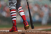 SAN FRANCISCO, CA - SEPTEMBER 2:  Detail of Dexter Fowler #28 of the St. Louis Cardinals knocking dirt out of his Nike cleats with his bat while wearing striped socks during the game against the San Francisco Giants at AT&T Park on Saturday, September 2, 2017 in San Francisco, California. (Photo by Brad Mangin)
