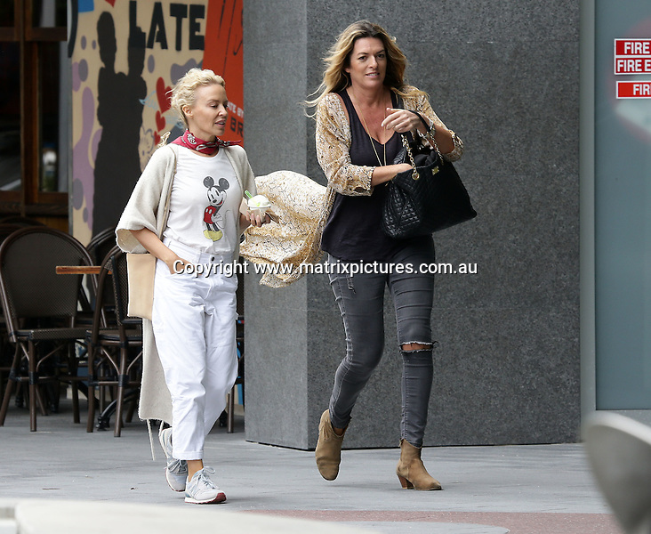 23 OCTOBER 2016 GOLD COAST AUSTRALIA<br /> WWW.MATRIXPICTURES.COM.AU<br /> <br /> EXCLUSIVE PICTURES<br /> <br /> Kylie Minogue pictured getting an ice cream on her day off from filming 'Flammable Children' on the Gold Coast, Queensland. Kylie wore a 'Mickey Mouse' Tshirt for the outing.