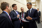 United States President Barack Obama talks with, from left, Press Secretary Jay Carney, Director of Communications Dan Pfeiffer, and Ben Rhodes, Deputy National Security Advisor for Strategic Communications, during the Nuclear Security Summit at the Coex Center in Seoul, Republic of Korea, March 27, 2012. .Mandatory Credit: Pete Souza - White House via CNP