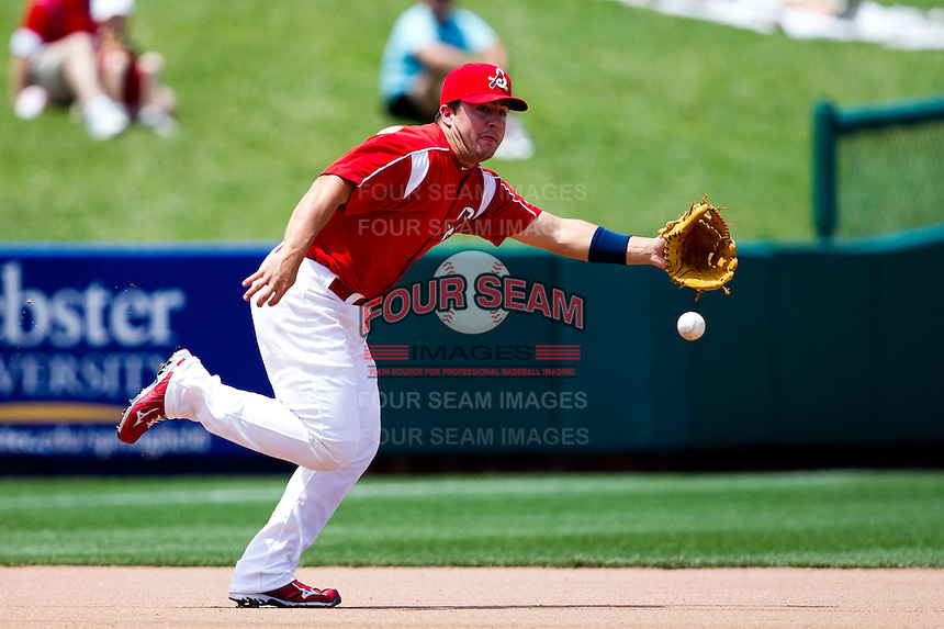 Zack Cox (7) of the Springfield Cardinals attempts to make a play on a line drive to third base during a game against the San Antonio Missions on May 30, 2011 at Hammons Field in Springfield, Missouri.  Photo By David Welker/Four Seam Images