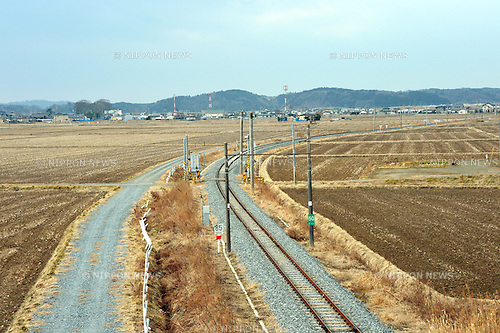March 8, 2013, Higashi-Matsushima, Japan - A single-track railway of the local railroad cuts through cultivated fields near Higashi-Matsushima, Miyagi Prefecture, on March 8, 2013. The Senseki Line that connects Sendai, the prefectural capital, with the port city of Ishinomaki on the Pacific coast, was severed two years ago on March 11 when the Magnitude 9.0 earthquake and ensuing tsunami struck the nation's northeast region, leaving more than 15,000 people dead and ravaging wide swaths of coastal towns and villages.  (Photo by Natsuki Sakai/AFLO)