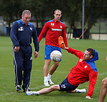 Kirk Broadfoot lunges in on Ally McCoist