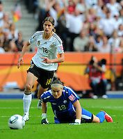 Kerstin Garefrekes (l) of Germany and Erin McLeod of Canada during the FIFA Women's World Cup at the FIFA Stadium in Berlin, Germany on June 26th, 2011.