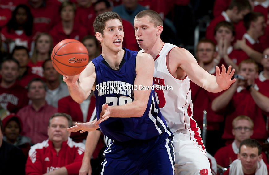 Wisconsin Badgers forward Jared Berggren (40) defends against Northwestern Wildcats David Curletti (30) during a Big Ten Conference NCAA college basketball game on January 18, 2012 in Madison, Wisconsin. The Badgers won 77-57. (Photo by David Stluka)