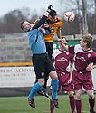 Arbroath keeper Scott Morrison is caught by Alloa's Ben Gordon.