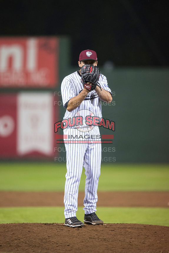 Idaho Falls Chukars relief pitcher Ted Cillis (24) looks in for the sign during a Pioneer League game against the Billings Mustangs at Melaleuca Field on August 22, 2018 in Idaho Falls, Idaho. The Idaho Falls Chukars defeated the Billings Mustangs by a score of 5-3. (Zachary Lucy/Four Seam Images)