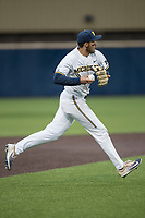 Michigan Wolverines third baseman Drew Lugbauer (17) makes a running throw to first base against the Michigan State Spartans on May 19, 2017 at Ray Fisher Stadium in Ann Arbor, Michigan. Michigan defeated Michigan State 11-6. (Andrew Woolley/Four Seam Images)