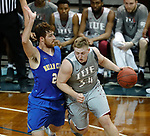 SIOUX FALLS, SD - MARCH 9:  Nate Niehoff #34 of IU East drives on	Blake Wiltgen #21 of Briar Cliff at the 2018 NAIA DII Men's Basketball Championship at the Sanford Pentagon in Sioux Falls. (Photo by Dick Carlson/Inertia)