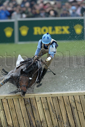1 May 2004: EMILY BALDWIN (GBR) falls from 'Welton Sparkle' while riding through The Lake during the cross country section of The Mitsubishi Horse Trials, Badminton, England. Photo: Glyn Kirk/ Action Plus...equestrian fence jump water women crash.040501 fall accident