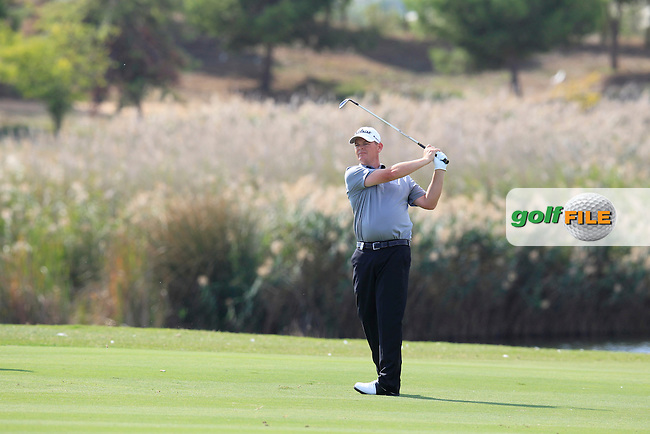 David Drysdale (SCO) plays his 2nd shot on the 14th hole during Sunday's Final Round of the 2013 Portugal Masters held at the Oceanico Victoria Golf Club. 13th October 2013.<br /> Picture: Eoin Clarke/www.golffile.ie