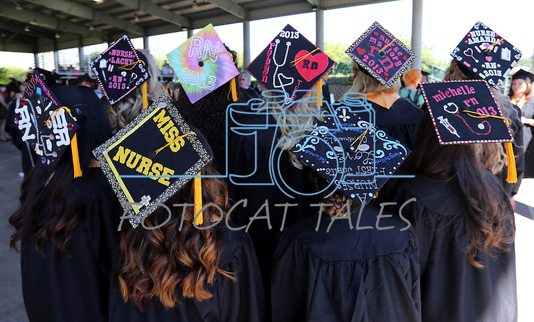 A group of nursing students show off their cap decorations before the 2013 Western Nevada College Commencement at the Pony Express Pavilion, in Carson City, Nev., on Monday, May 20, 2013. .Photo by Cathleen Allison