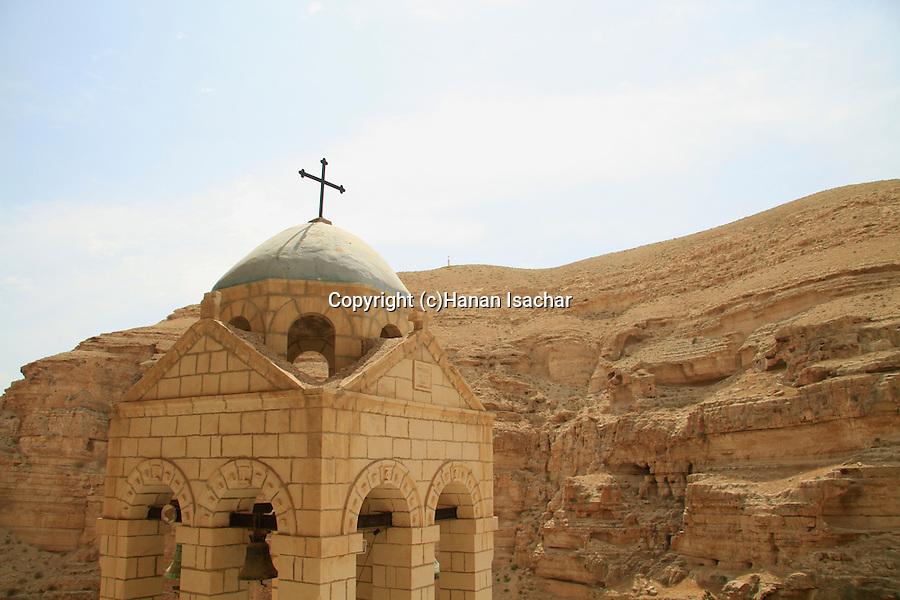 Judean Desert, the bell tower of the Greek Orthodox St. George of Koziba Monastery on the slope of Wadi Qelt