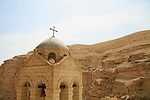 Judean Desert, the bell tower of the Greek Orthodox St. George of Koziba Monastery on the slope of Wadi Qelt
