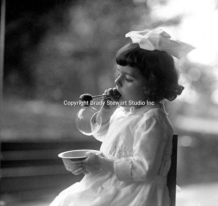 Point Breeze:  Helen Stewart blowing bubbles on grandma's back porch - 1919. During this time the Stewart's lived at 6705 Thomas Street in Point Breeze.