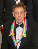 Philip Glass, one of the recipients of the 41st Annual Kennedy Center Honors, as he poses for a group photo following a dinner hosted by United States Deputy Secretary of State John J. Sullivan in their honor at the US Department of State in Washington, D.C. on Saturday, December 1, 2018. The 2018 honorees are: singer and actress Cher; composer and pianist Philip Glass; Country music entertainer Reba McEntire; and jazz saxophonist and composer Wayne Shorter. This year, the co-creators of Hamilton, writer and actor Lin-Manuel Miranda; director Thomas Kail; choreographer Andy Blankenbuehler; and music director Alex Lacamoire will receive a unique Kennedy Center Honors as trailblazing creators of a transformative work that defies category.<br /> Credit: Ron Sachs / Pool via CNP