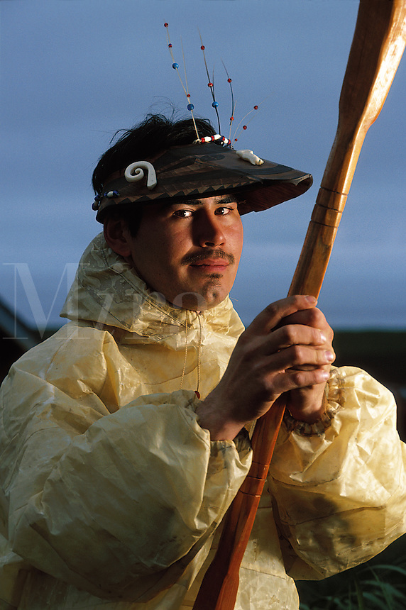 Portrait of a male Native Alaskan Tlingit wearing a traditional hunting hat and Kamleika (raincoat.). Alaska.