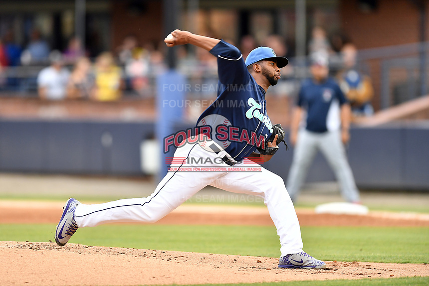 Asheville Tourists starting pitcher Frederis Parra (26) delivers a pitch during a game against the Rome Braves at McCormick Field on July 18, 2019 in Asheville, North Carolina. The Tourists defeated the Braves 4-3. (Tony Farlow/Four Seam Images)