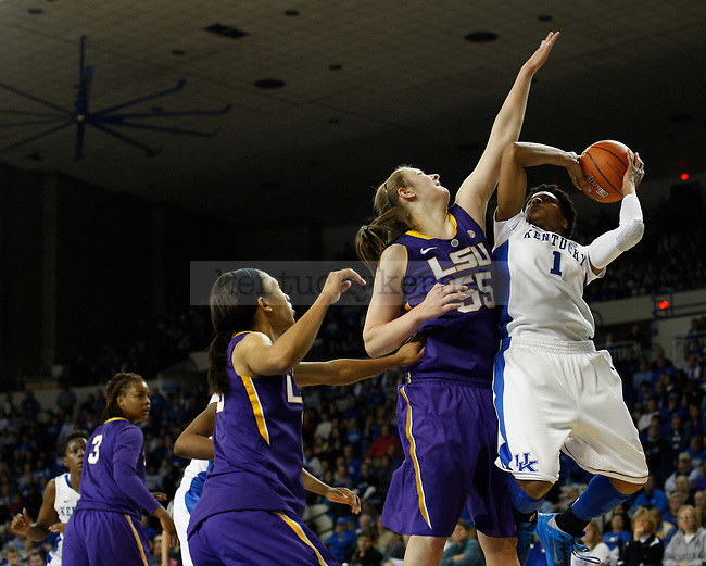 UK guard A'dia Mathies attempts a shot but is defended by LSU forward Theresa Plaisance during the first half of the women's basketball game vs. LSU Memorial Coliseum , in Lexington, Ky., on Sunday, January 27, 2013. Photo by Genevieve Adams  | Staff.