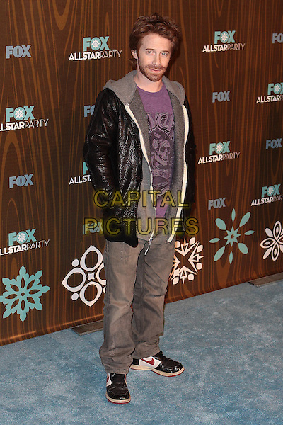 SETH GREEN.Fox Winter All Star  Party held at Villa Sorisso, Pasadena, California, USA..January 11th, 2009.full length black leather jacket purple top jeans denim hands in pockets .CAP/ADM/TC.©T. Conrad/AdMedia/Capital Pictures.