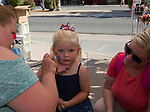 Three year old Kaylynn gets her face painted by Wendy as her mom watches during Star Spangled Sparks on Wednesday July 4, 2018 in downtown Sparks.