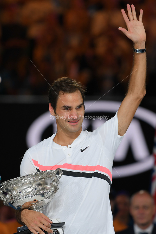 January 28, 2018: Number two seed Roger Federer of Switzerland poses for photographs with the trophy and sheds a tear after winning the Men's Final against number six seed Marin Cilic of Croatia on day fourteen of the 2018 Australian Open Grand Slam tennis tournament in Melbourne, Australia. Federer won 3 sets to 2. Photo Sydney Low