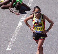 Caroline Kilel of Kenya on the ground after winning  the 115th. running of the Boston Marathon with a time of 2:22.36  as 2nd. place finisher Desiree Davila walks by after finishing with a time of 2:22:38 on Monday, April 18th. 2011. Photo by Errol Anderson