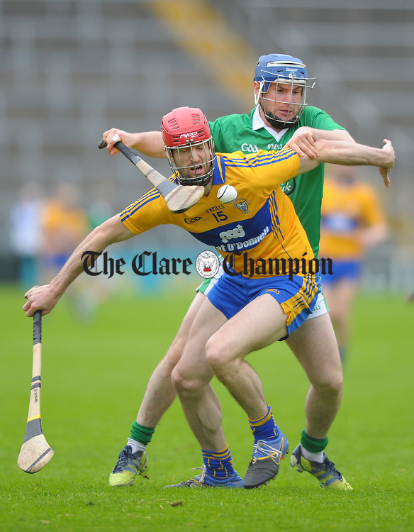Darach Honan of Clare in action against Richie Mc Carthy of Limerick during their game at Semple Stadium. Photograph by John Kelly.
