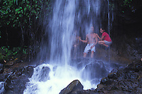 Family at a waterfall on the Kalihiwai River, North Shore of Kauai