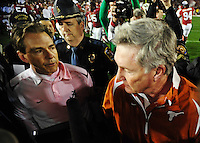 Jan 7, 2010; Pasadena, CA, USA; Alabama Crimson Tide head coach Nick Saban (left) shakes hands with Texas Longhorns head coach Mack Brown after the 2010 BCS national championship game at the Rose Bowl.  Aalbama won 37-21. Mandatory Credit: Mark J. Rebilas-