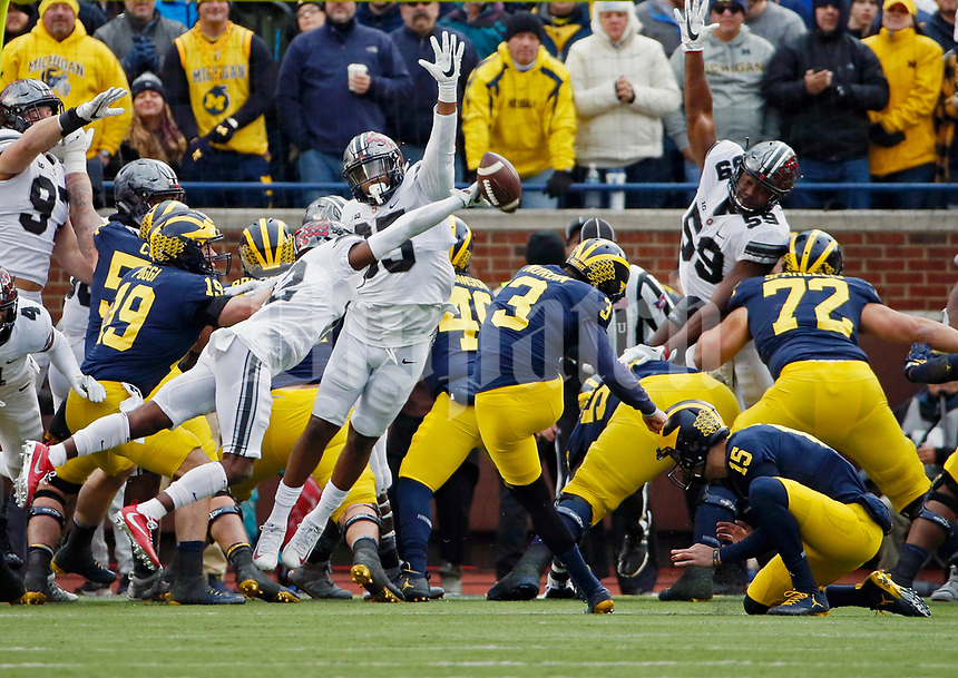 Ohio State Buckeyes cornerback Denzel Ward (12) blocks an extra point from Michigan Wolverines place kicker Quinn Nordin (3) during the 2nd half of their game at Michigan Stadium on November 25, 2017.  [Kyle Robertson\ Dispatch]