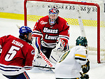 6 November 2009: University of Massachusetts Lowell River Hawks' goaltender Nevin Hamilton, a Senior from Ashland, MA, makes a third period save against the University of Vermont Catamounts at Gutterson Fieldhouse in Burlington, Vermont. The Hockey East rivals battled to a 3-3 tie. Mandatory Credit: Ed Wolfstein Photo