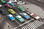 Havana, Cuba; an elevated view of the classic American cars at an intersection during morning rush hour
