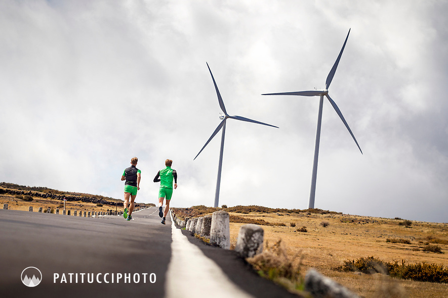 Road running on a wide open flat road with wind turbines in the distance on Madeira Island