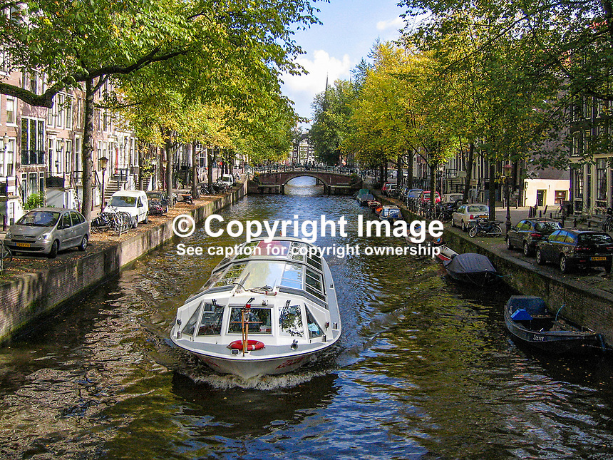Netherlands, Holland, Amsterdam, canal, canal boat, boat, trees, streets, 200710050079..Copyright Image from Victor Patterson, 54 Dorchester Park, Belfast, UK, BT9 6RJ..Tel: +44 28 9066 1296.Mob: +44 7802 353836.Voicemail +44 20 8816 7153.Skype: victorpattersonbelfast.Email: victorpatterson@mac.com.Email: victorpatterson@ireland.com (back-up)..IMPORTANT: If you wish to use this image or any other of my images please go to www.victorpatterson.com and click on the Terms & Conditions. Then contact me by email or phone with the reference number(s) of the image(s) concerned.