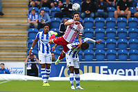Chris Whelpdale of Stevenage and Kyel Reid of Colchester United during Colchester United vs Stevenage, Sky Bet EFL League 2 Football at the Weston Homes Community Stadium on 12th August 2017