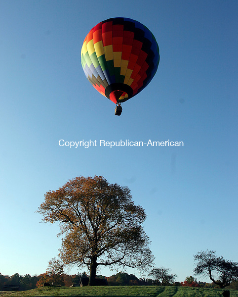 """MIDDLEBURY, CT-10October 2006-101006TK04- (left to right) The balloon called """"The Last Penny"""" rises from the Fenn property in Middlebury to begin photographing the video bicentennial project of Middlebury.  Tom Kabelka Republican-American ((Middlebury Bicentennial Celebration)"""