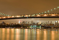 Williamsburg Bridge, East River and Manhattan Skyline, Illuminated at Night, New York City, New York State, USA