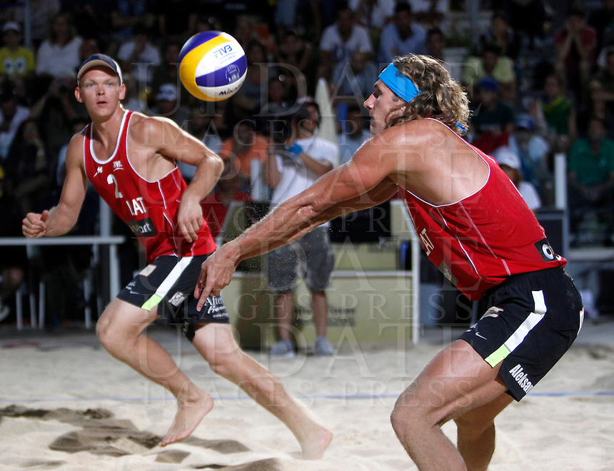 Latvia's Aleksandrs Samoilovs, right, and Janis Smedins in action during the men's final match between Usa and Latvia at the Beach Volleyball World Tour Grand Slam, Foro Italico, Rome, 23 June 2013. USA defeated Latvia 2-0.<br /> UPDATE IMAGES PRESS/Isabella Bonotto