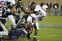 6 November 2010:  FIU linebacker Winston Fraser (34) and linebacker Toronto Smith (13) combine to tackle Louisiana-Monroe running back Frank Goodin (5) in the first quarter as the FIU Golden Panthers defeated the University of Louisiana-Monroe Warhawks, 42-35 in double overtime, at FIU Stadium in Miami, Florida.