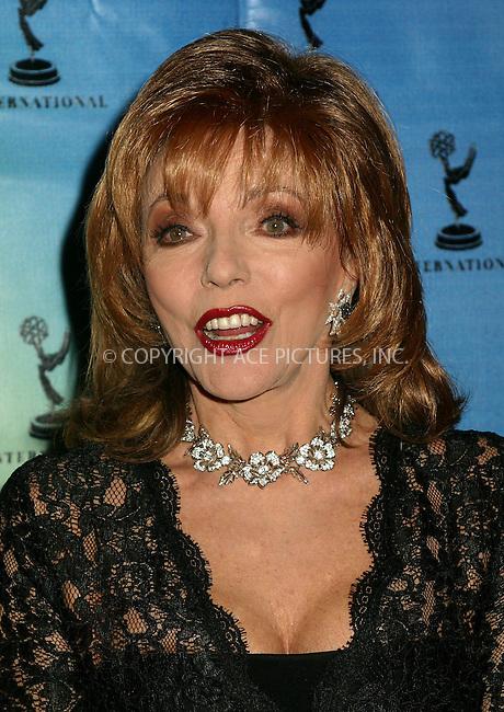 Joan Collins at the 30th International Emmy Awards in New York. November 25, 2002. Please byline: Alecsey Boldeskul/NY Photo Press.   ..*PAY-PER-USE*      ....NY Photo Press:  ..phone (646) 267-6913;   ..e-mail: info@nyphotopress.com