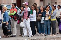 Cuba, Havana.  Cubans Waiting to Board a Bus.