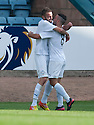 Morton's Tomas Peciar (4) celebrates with Dougie Imrie (8) after he scores their first goal.